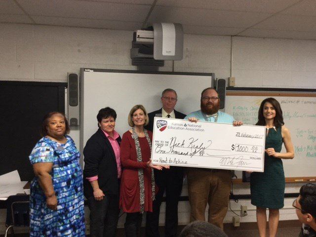 Teacher Nick Kraly received a $1,000 check from the Kansas chapter of the National Education Association. (Submitted)
