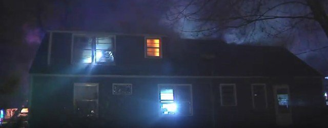 The woman inside the house was able to get out unharmed. (KCTV5)