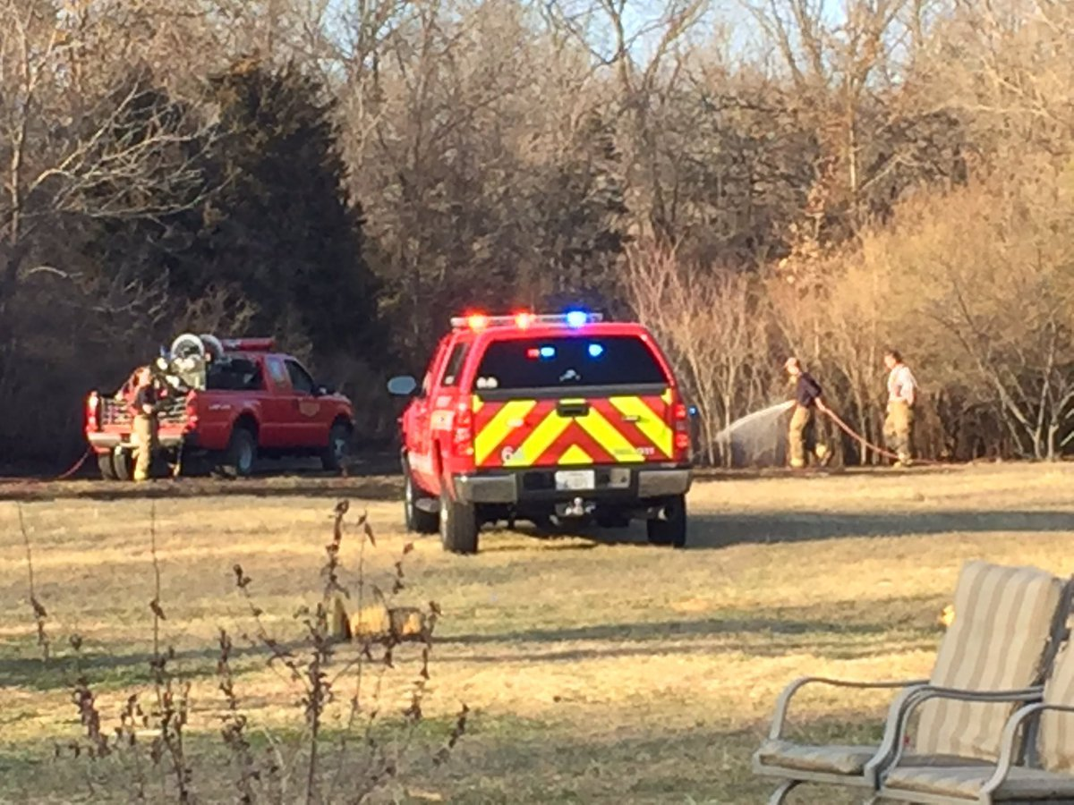 Firefighters said the fire started in a wooded area. (KCTV)