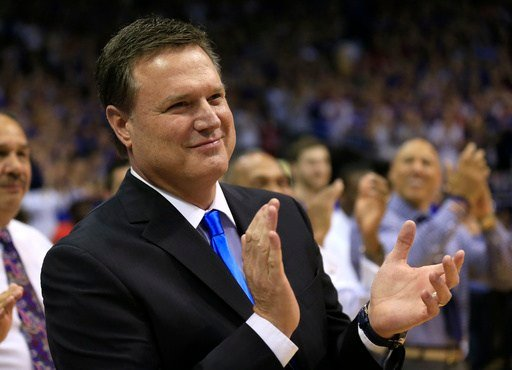 Kansas head coach Bill Self applauds his seniors before an NCAA college basketball game against Oklahoma in Lawrence, Kan., Monday, Feb. 27, 2017. (AP Photo/Orlin Wagner)