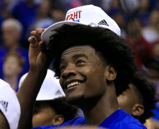 Kansas guard Josh Jackson dons his Big 12 championship hat following the team's NCAA college basketball game against TCU in Lawrence, Kan., Wednesday, Feb. 22, 2017. (AP Photo/Orlin Wagner)