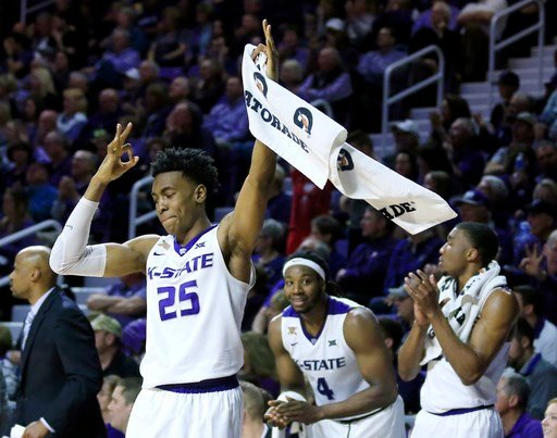 Kansas State senior Wesley Iwundu (25) celebrates a 3-point basket while on the bench during the second half of an NCAA college basketball game against Texas Tech in Manhattan, Kan., Saturday, March 4, 2017. (AP Photo/Orlin Wagner)