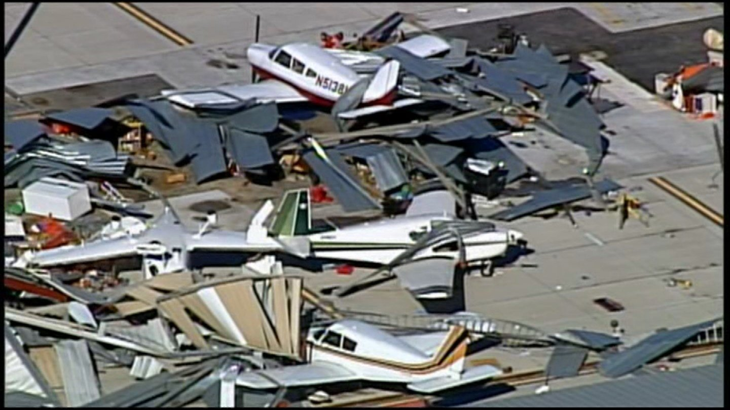 A storm system pummeled the Johnson County Executive Airport, destroying or damaging several hangars and flipping some airplanes onto their sides. (Chopper5)