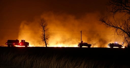(Bo Rader/The Wichita Eagle via AP). Firefighters from across Kansas and Oklahoma battle a wildfire near Protection, Kan., Monday, March 6, 2017.