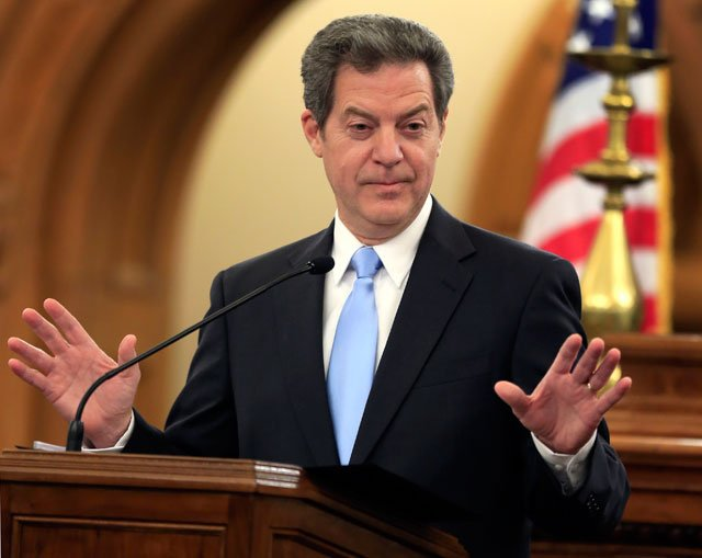 Kansas Gov. Sam Brownback isn't committing to staying in that job through the end of the legislative session this spring. (AP)