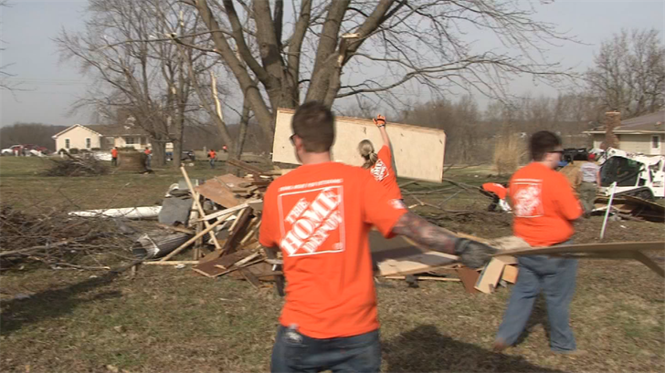 Volunteers from Home Depot stores across KC came to help those affected by the Oak Grove tornado. (KCTV)