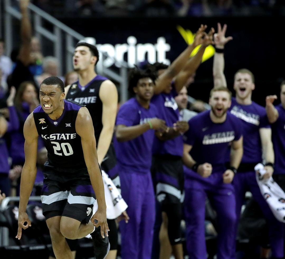 Kansas State's Xavier Sneed (20) celebrates after scoring a basket during the second half of the team's NCAA college basketball game against Baylor Thursday night. (AP)