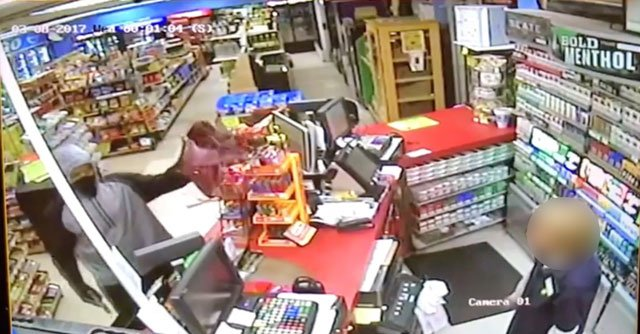 Police say the robbery happened just after 11:30 p.m. at the BP on Northeast Parvin Road near 51st Street. (KCPD)