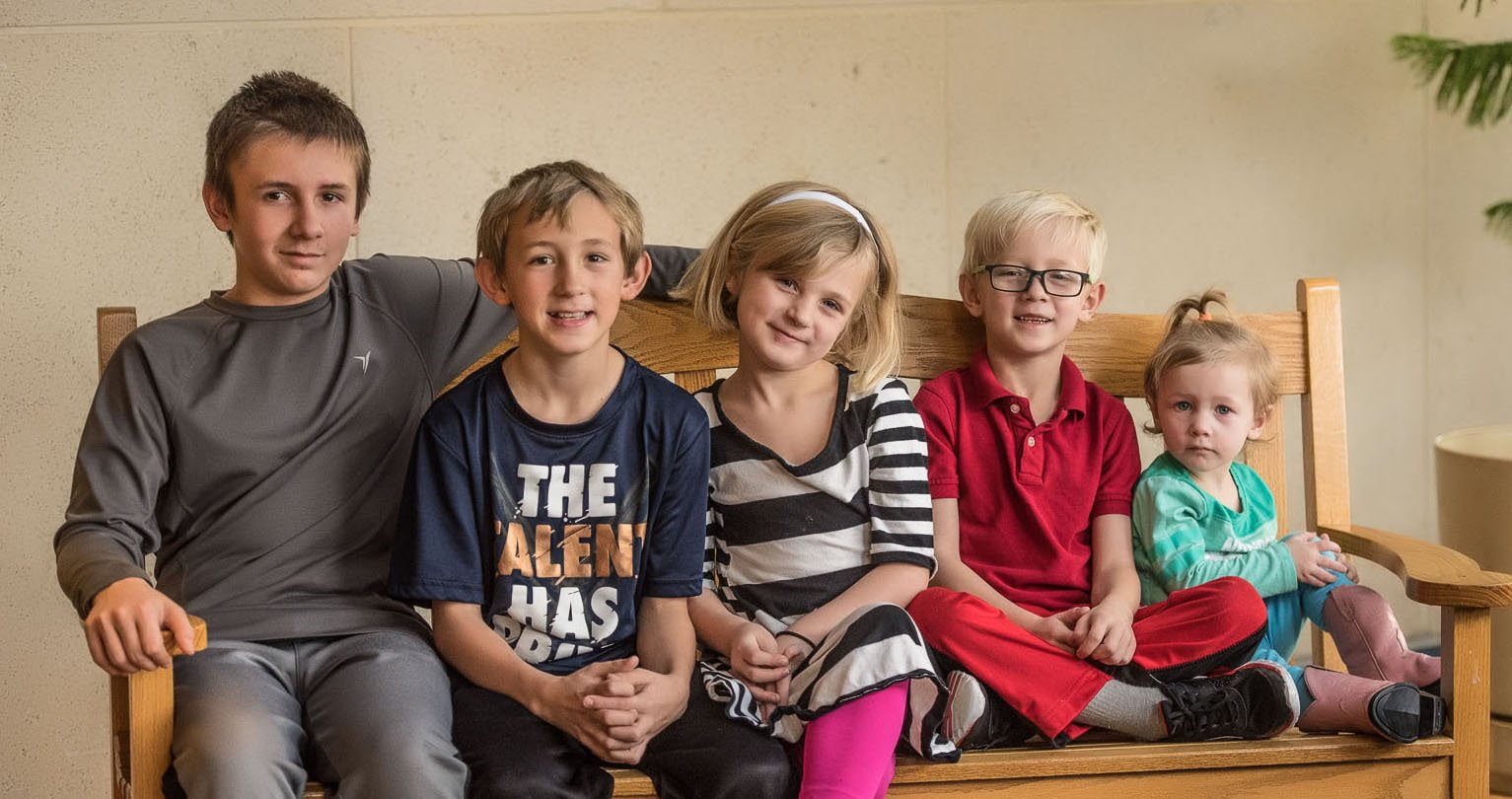 Five Kansas siblings whose request to be adopted together drew thousands of inquiries from around the world are officially a family. (Mark Weber/Wichers Photography Inc.)