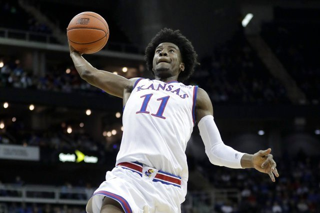 "A court affidavit says Kansas basketball player Josh Jackson threatened to ""beat"" women's basketball player McKenzie Calvert during a confrontation at a Lawrence bar. (AP)"