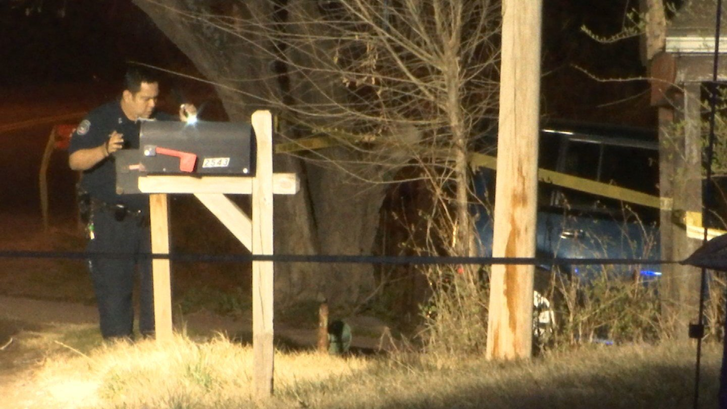 Police investigate in the area where a man's body was found in a ditch. (KCTV)