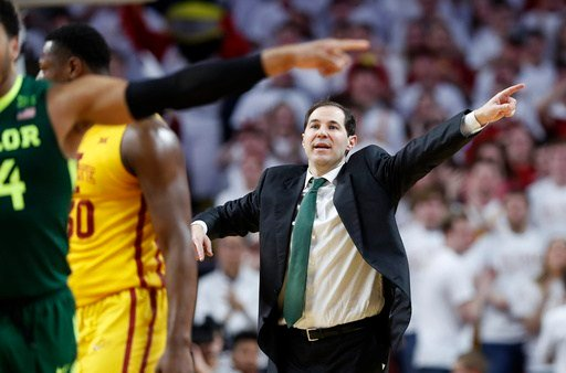 Baylor Bears men's basketball head coach Scott Drew congratulated the Jayhawks prior to his team's game against USC. (AP)