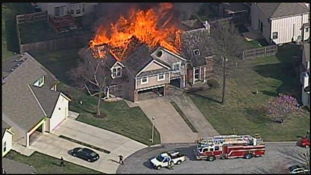 Firefighters were battling a massive fire at an apartment complex in Overland Park on Monday. The fire then spread to other homes in the area of College and Switzer. (KCTV5)