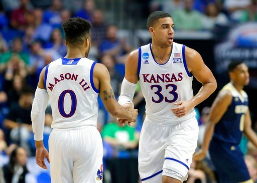 Kansas' Frank Mason III (0) and Landen Lucas (33) celebrate a basket against UC Davis in the first half of a first-round game in the men's NCAA college basketball tournament in Tulsa, Okla., Friday March 17, 2017. (AP Photo/Tony Gutierrez)