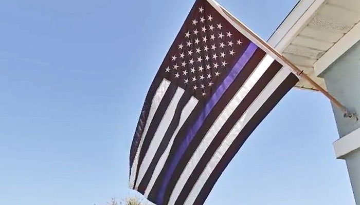 A homeowners association told a Florida homeowner to remove a Blue Lives Matter flag from her front yard. (Source: WFOX/WJAX/CNN)