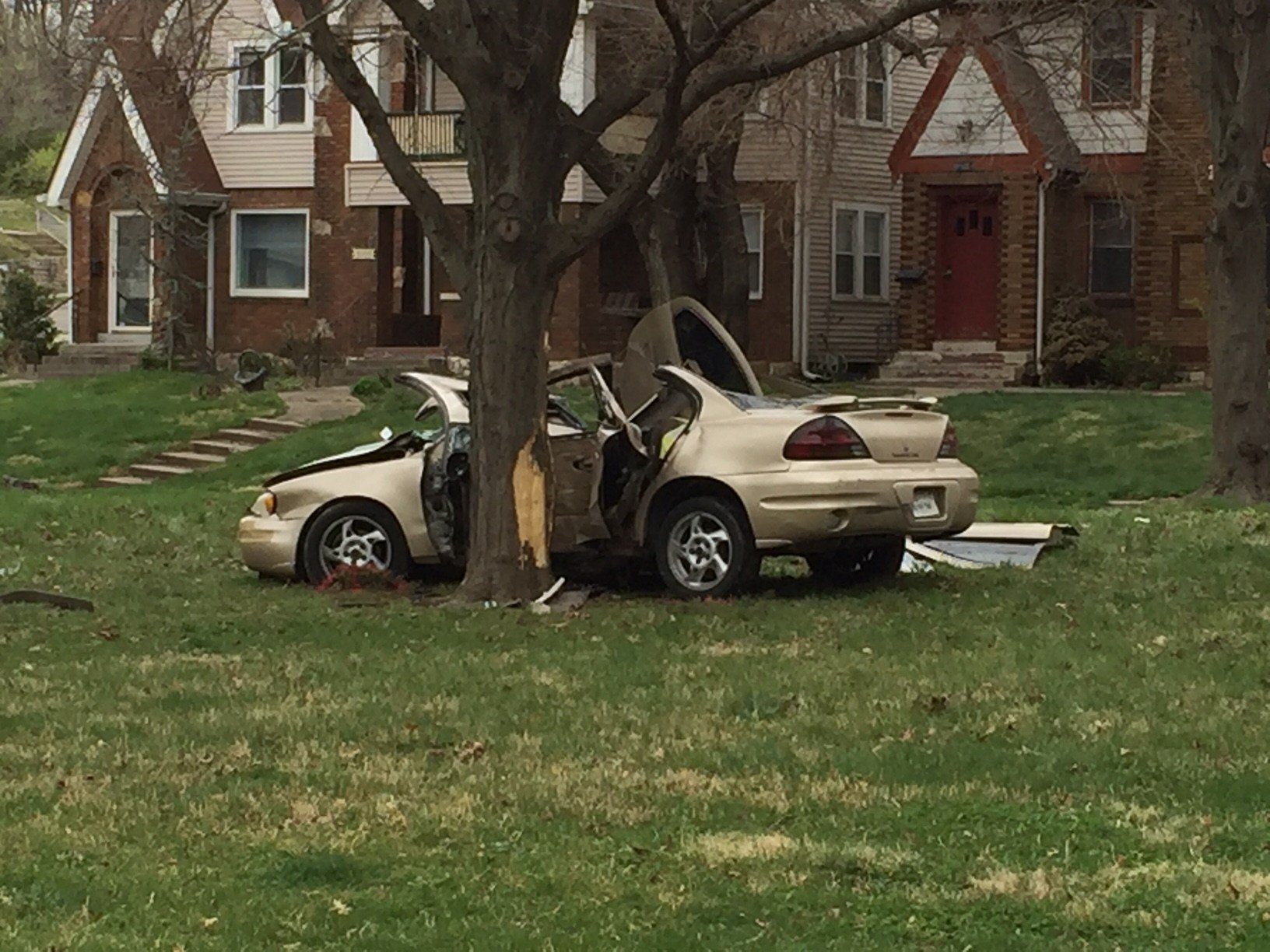 The car ran into a pole before hitting the tree. (Dwain Crispell/KCTV)