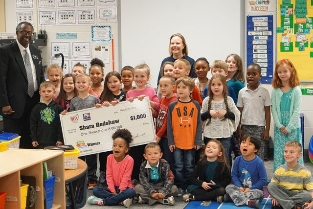 Kindergarten teacher Shara Redshaw received a $1,000 check from the Missouri chapter of the National Education Association. (Missouri NEA)