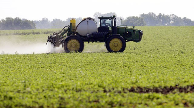 Missouri Gov. Eric Greitens has signed a law to increase fines for illegal use of herbicides that damage other farmers' crops. (AP)