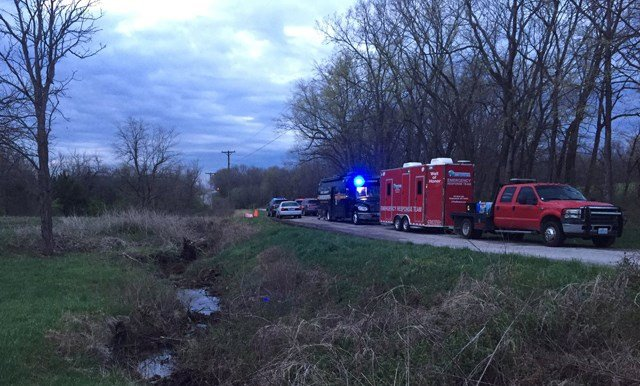 Nearly 100 people will continue to search the wooded area near E 233rd Street and State Route Y where the remains were found. (KCTV5)