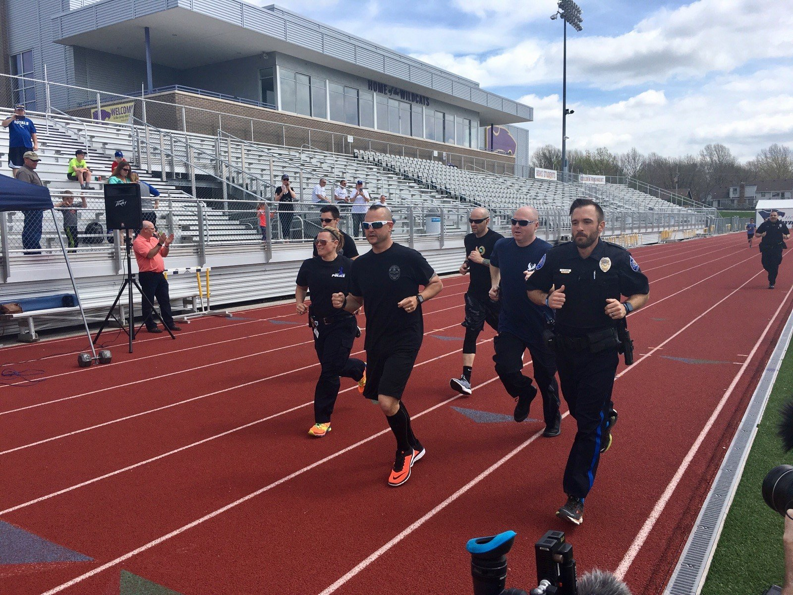 Hughes decided to run a marathon, wearing his full police uniform. Throughout the day, others joined in to walk or run a 5K. (KCTV)