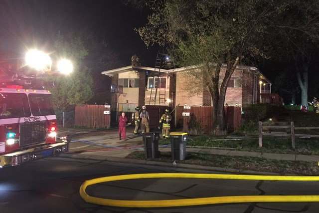 Fire officials say the fire caused heavy damage to the attic and roof of the duplex. (KCTV5)