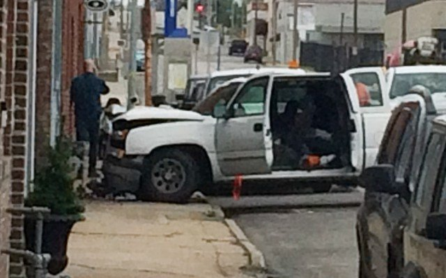 A gas meter has been dislodged after a truck drove into a building on Friday. (KCTV5)