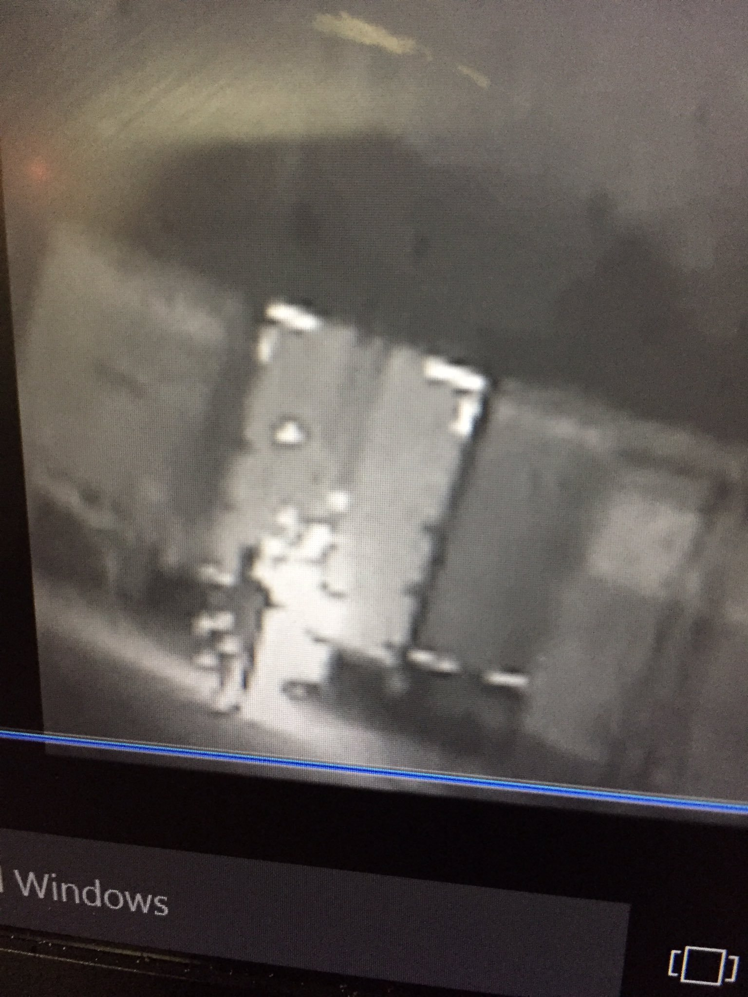 The shocking surveillance video, from the Kansas City Police Department, shows sparks flying off trailers full of donated goods. (Kansas City Police Department)