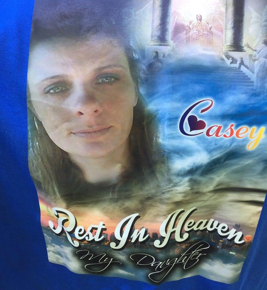 The design printed on shirts worn at the vigil. (KCTV)