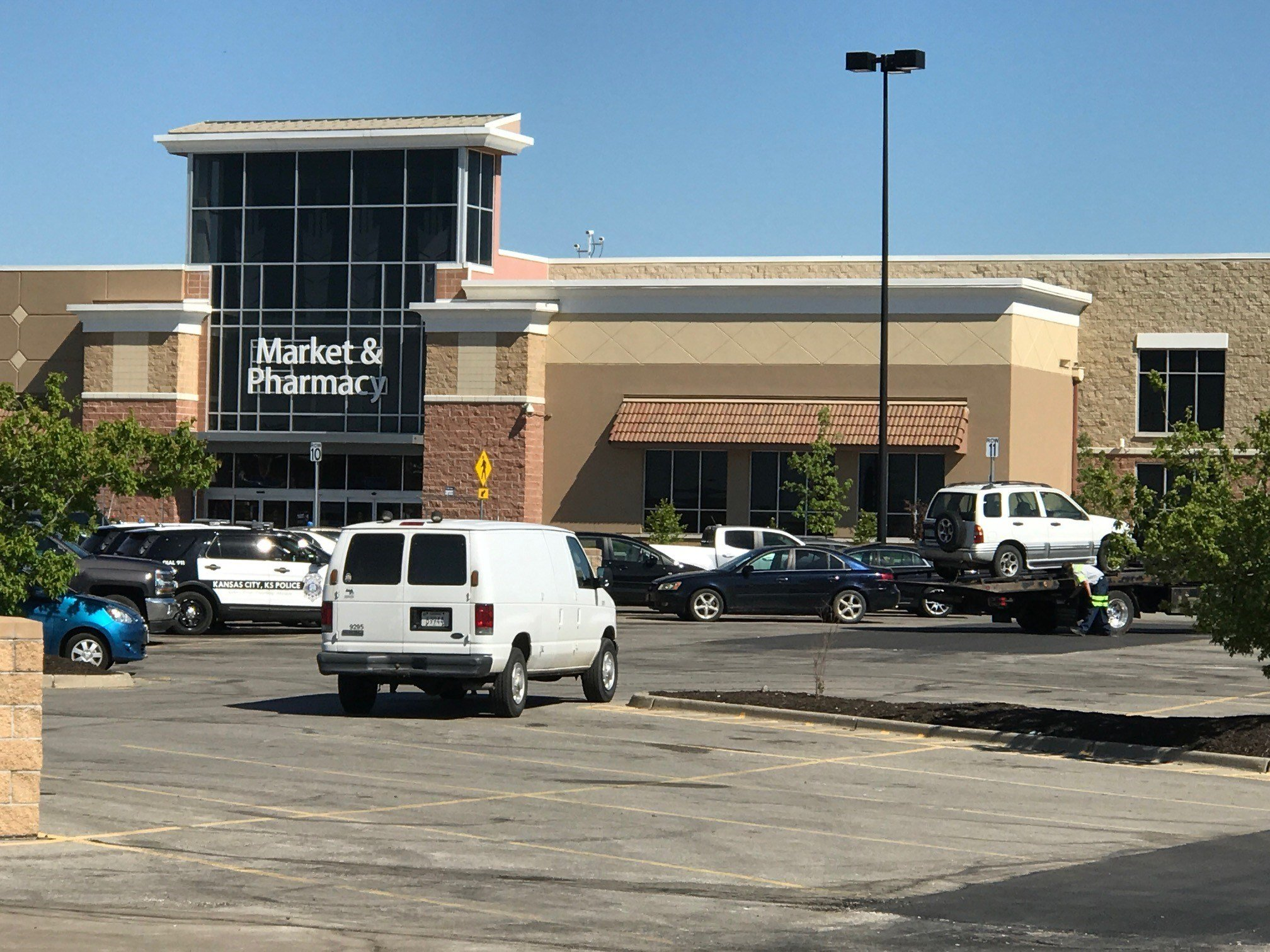 The two individuals police found in the parking lot of Walmart died from carbon monoxide poisoning, authorities said Tuesday. (Eric Smith/KCTV)