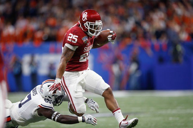 Oklahoma running back Joe Mixon (25) carries against Auburn linebacker Deshaun Davis (57) in the first half of the Sugar Bowl NCAA college football game in New Orleans, Monday, Jan. 2, 2017. (AP Photo/Gerald Herbert)