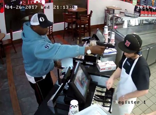 Detectives said a man wearing a light blue hooded sweatshirt entered the restaurant, placed an order, then pointed a gun at the cashier demanding money from the register. (KCPD)