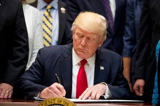 (AP Photo/Andrew Harnik). President Donald Trump signs the Education Federalism Executive Order during a federalism event with governors in the Roosevelt Room of the White House in Washington, Wednesday, April 26, 2017. (AP)
