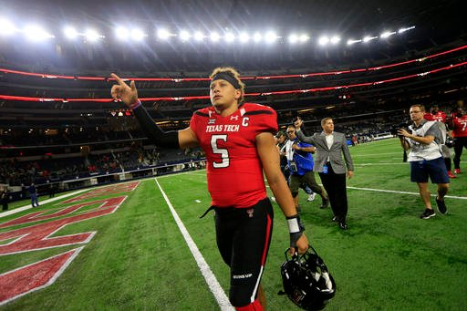 Texas Tech quarterback Patrick Mahomes II celebrates after Tech defeated Baylor in an NCAA college football game Friday, Nov. 25, 2016, in Arlington, Texas. Texas Tech won 54-35. (AP Photo/Ron Jenkins)