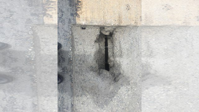 A pothole on I-70 near The Paseo that damaged over a dozen cars over the weekend has now been fixed. (Submitted to KCTV)