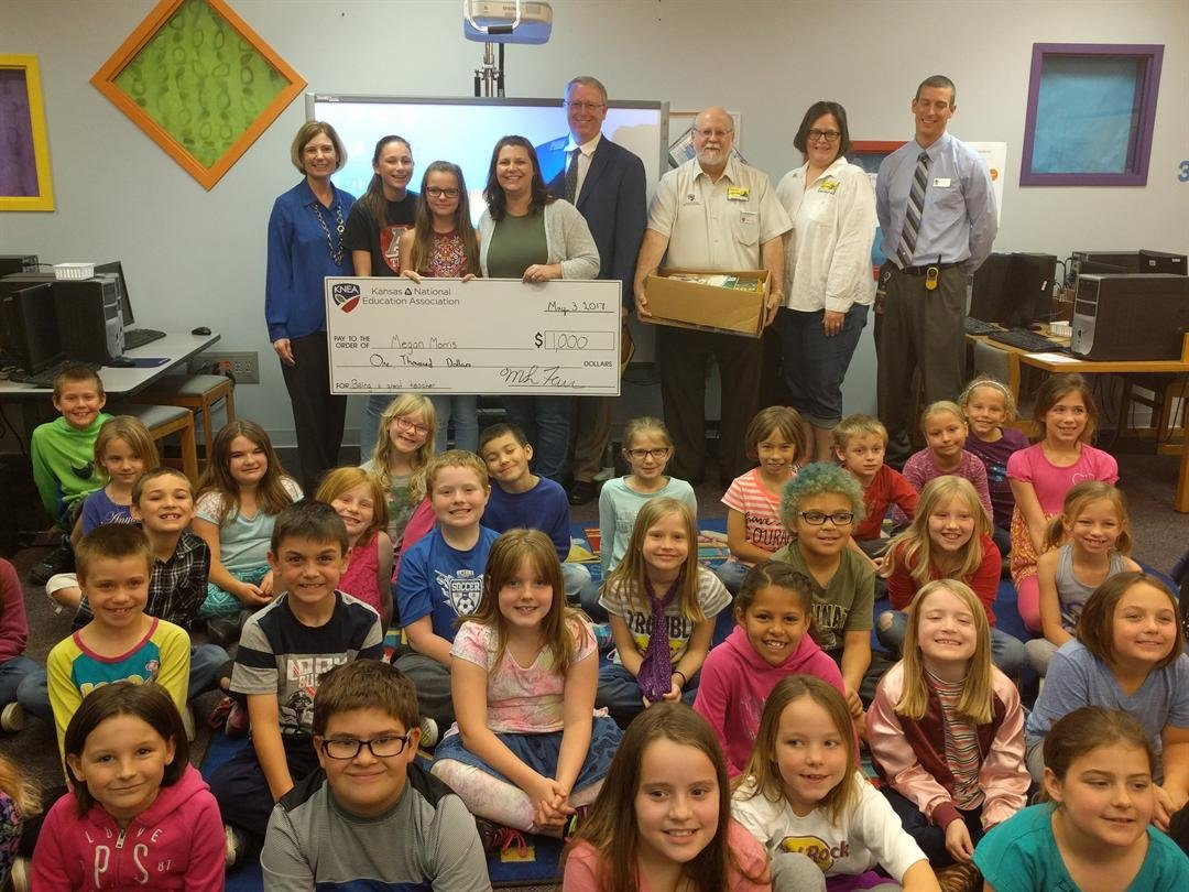Second-grade teacher Megan Morris received a $1,000 check from the Kansas chapter of the National Education Association. (KNEA)