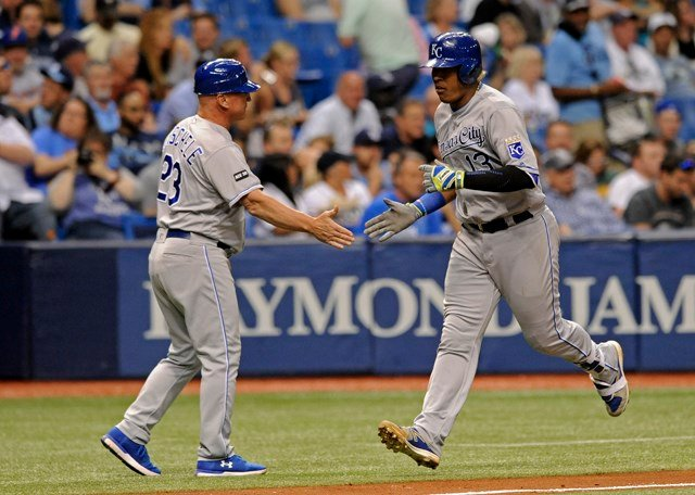 Kansas City Royals third base coach Mike Jirschele congratulates Salvador Perez, right after his two-run homer off Tampa Bay Rays starter Matt Andriese during the sixth inning . (AP)
