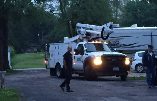 Kansas City Power and Light arrived and cut power to the lines. (KCTV5)