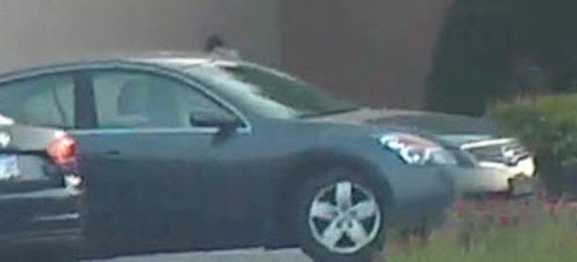 Police say the man was driving a mid-2000s dark gray or black Nissan Altima. (Lenexa PD)