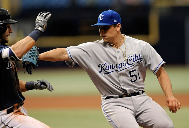 Kansas City Royals starter Jason Vargas (51) tags out Tampa Bay Rays' Kevin Kiermaier on a bunt down the first base line during the fifth inning of a baseball game Thursday, May 11, 2017, in St. Petersburg, Fla. (AP Photo/Steve Nesius)