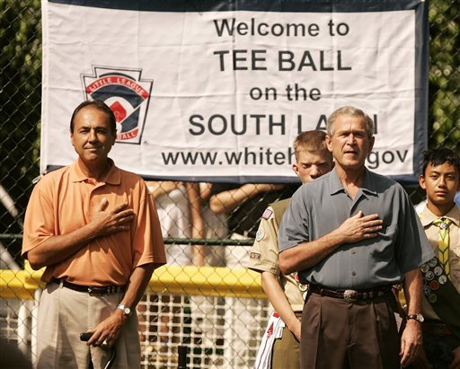 President George W. Bush, right, and White House Tee Ball Commissioner of the Game Steve Palermo participate in the singing of the National Anthem before the start of the Tee Ball on the South Lawn game, Sunday, July 24, 2005 at the White House. (AP)