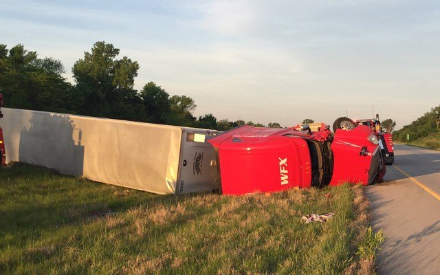 A semi is overturned in the median due to the accident. (KCTV5)