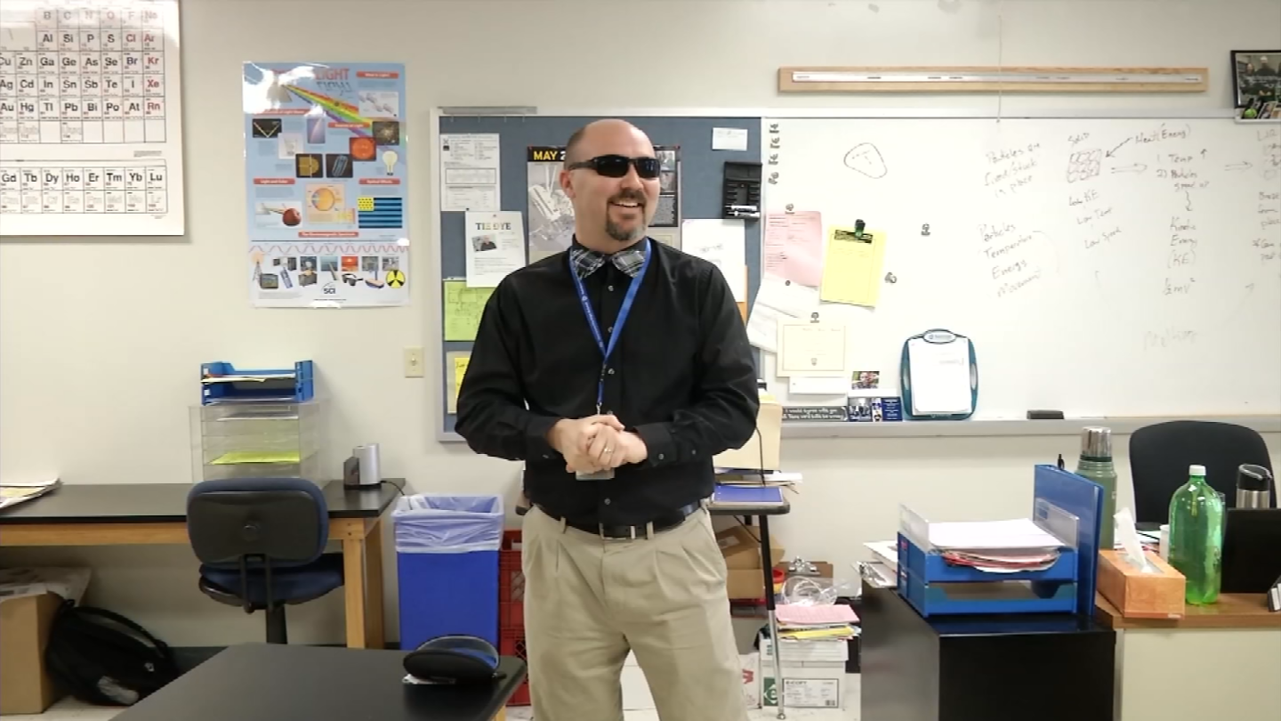 Harrisonville High School science teacher John Magoffin was born colorblind, so the art club raised money for a pair of glasses that helps him distinguish colors. (KCTV)