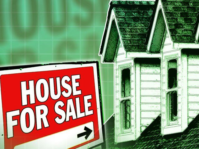"""Now that the sun is out and """"For Sale"""" signs are up, it's a popular time to buy a house. (AP)"""