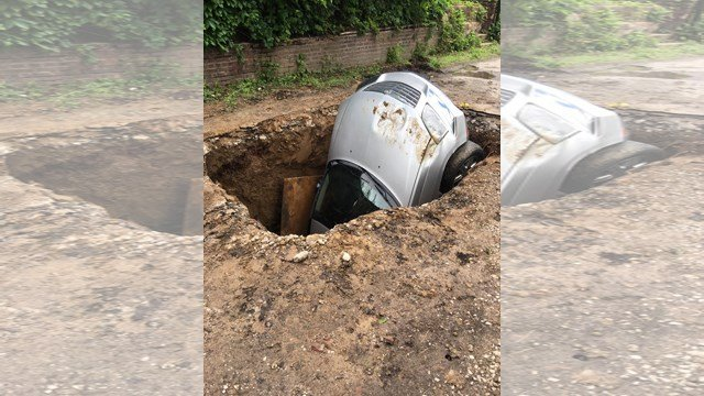 The driver was trapped inside the van after it went into the deep hole. (KCTV/Nathan Vickers)