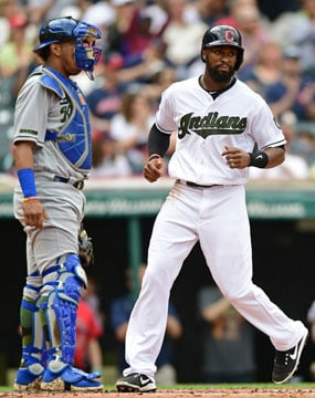 Cleveland Indians' Austin Jackson scores on a RBI single by Jason Kipnis in the third inning of a baseball game against the Kansas City Royals, Sunday, May 28, 2017, in Cleveland. Kansas City Royals catcher Salvador Perez waits. (AP Photo/David Dermer)