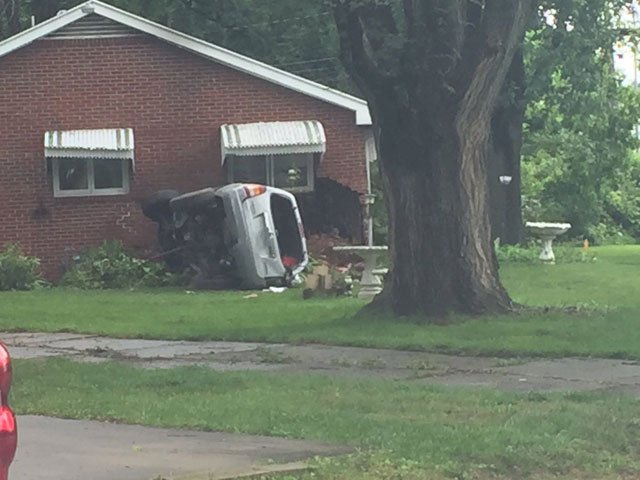 The crash happened about 8 a.m. at a home in the 7800 block of Blue Ridge Boulevard. (Jessica Reyes/KCTV5 News)
