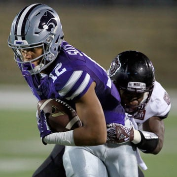 Kansas State wide receiver Corey Sutton (12) is tackled by Missouri State cornerback Matt Rush, back, during the first half of an NCAA college football game in Manhattan, Kan., Saturday, Sept. 24, 2016. (AP Photo/Orlin Wagner)