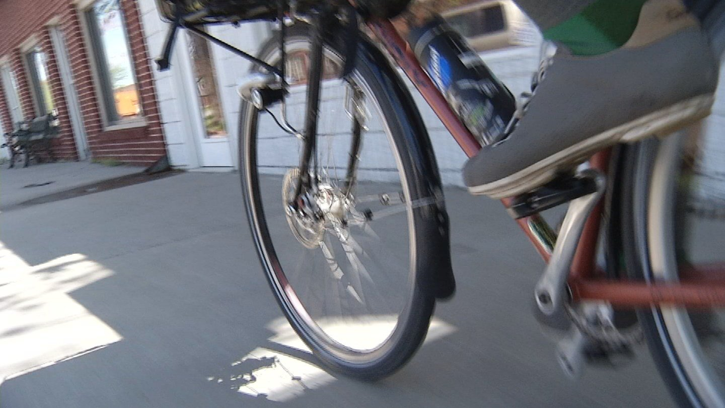 A new ordinance says cyclists in the city now have to walk their bike when near the city center, city hall, the parking garage and the rec center. (KCTV5)