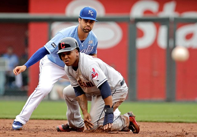 Kansas City Royals second baseman Whit Merrifield, top, throws wide for an error after forcing Cleveland Indians' Jose Ramirez, bottom, out at second during the fifth inning of a baseball game Sunday, June 4, 2017, in Kansas City, Mo. (AP)