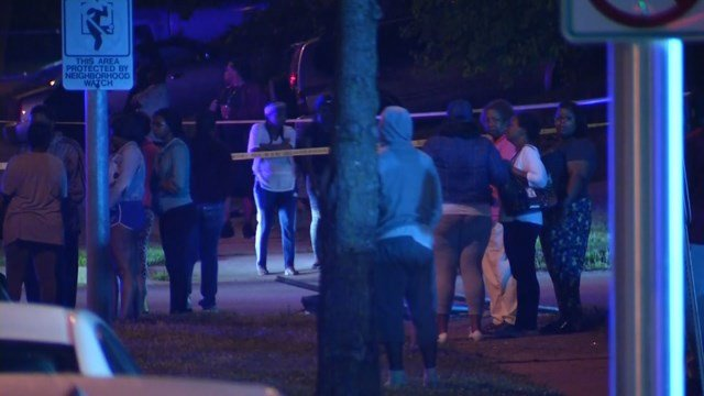 Several of the unnamed victims' family members and friends gathered at the scene Wednesday morning. (KCTV5)